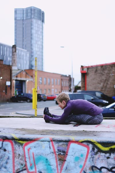 Helen doing a forward bend in Liverpool city Centre